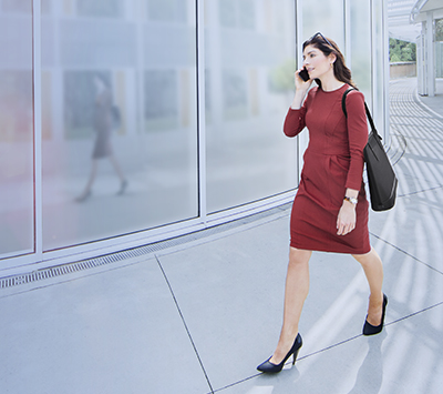 Professional woman walking outside a building